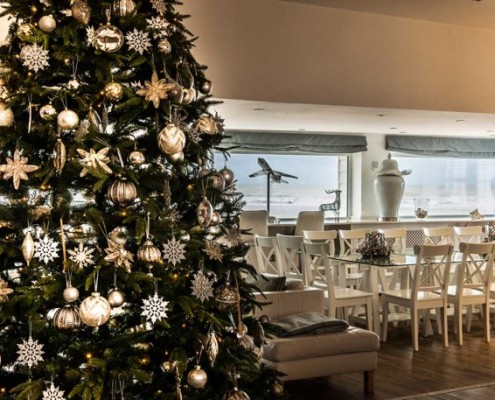 one of the many reasons guests choose luxury beach house rental for their seaside stay is the beautifully designed interiors of each of our properties - Rent A Decorated Christmas Tree